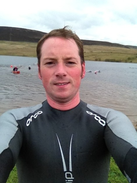 Cold on day one, me in the borrowed wetsuit!